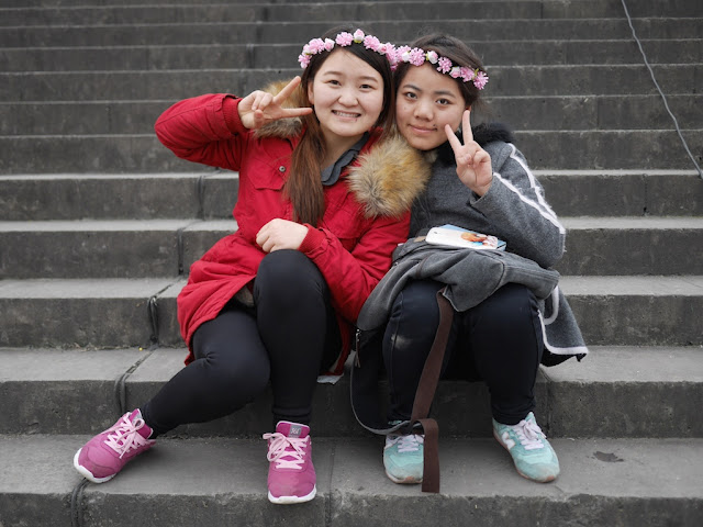 two Chinese female college students wearing flower headbands