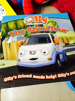 Blake and Maegan  Clement reading Olly the Little White Van Books