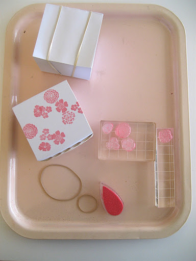 Rubber-banding the pad and gripping it together tightly will make for neater stamping. I used the cute floral stamps in our Peg Stamp Starter Kit and our butterfly stamps.