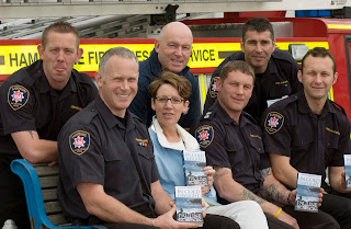 Pauline Rowson with firefighters from Red Watch UK