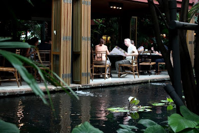 Pond and restaurant at the Jim Thompson House museum in Bangkok Thailand