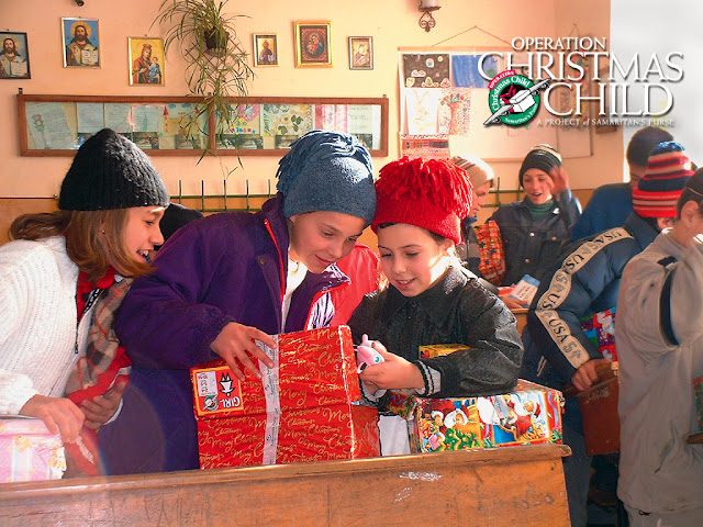 Operation Christmas Child girl with shoebox gift