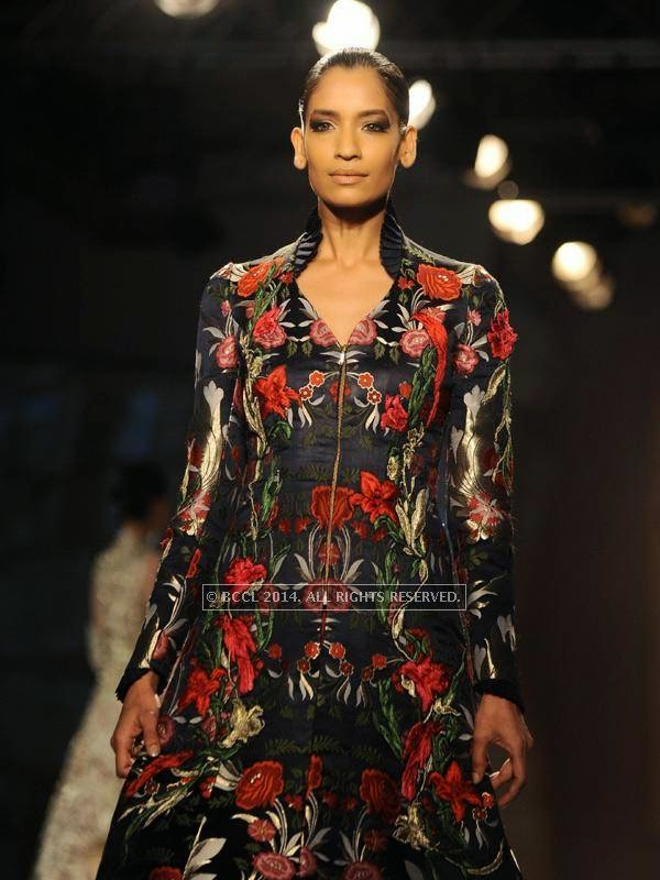Krishna Somani showcases a creation by designer Gaurab Gupta on Day 3 of India Couture Week, 2014, held at Taj Palace hotel, New Delhi.