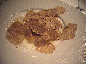 French Laundry- Carnaroli Risotto Biologico, with Castelmagno cheese and shaved white truffles from Alba. The foam you see around the risotto is truffle oil, and after the white truffle was added it was finished with melted Vermont butter.