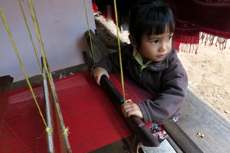 Little girl pretending to use the loom