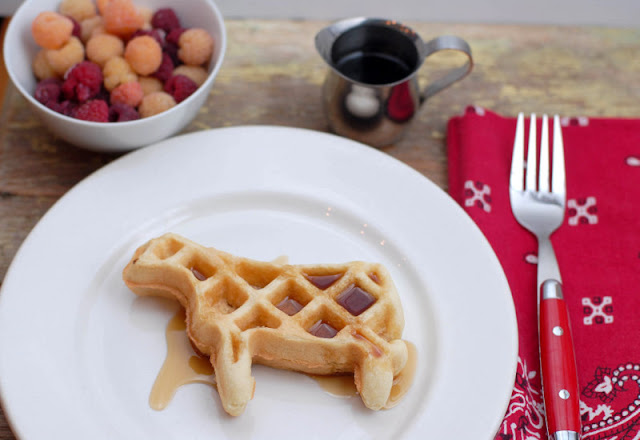 cow shaped waffle with syrup on plate