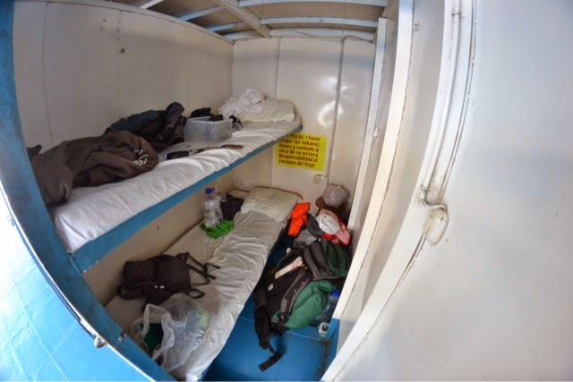 Cabin on cargo boat sailing down amazon