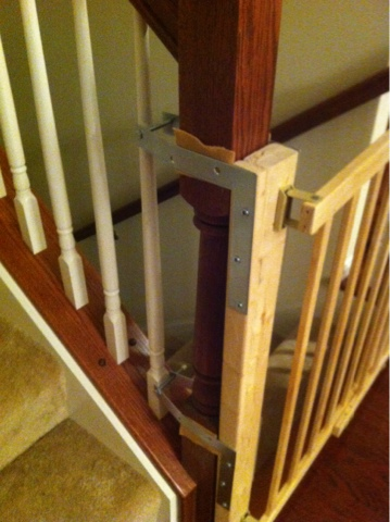 Added felt to help keep the metal brackets from damaging the wood banister.