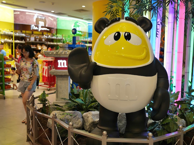 M&M's character in a panda costume