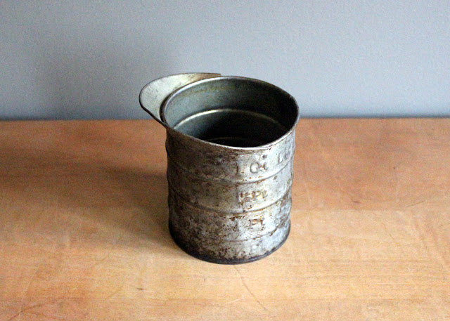 Rusty tin measuring cups available for rent from www.momentarilyyours.com, $1.