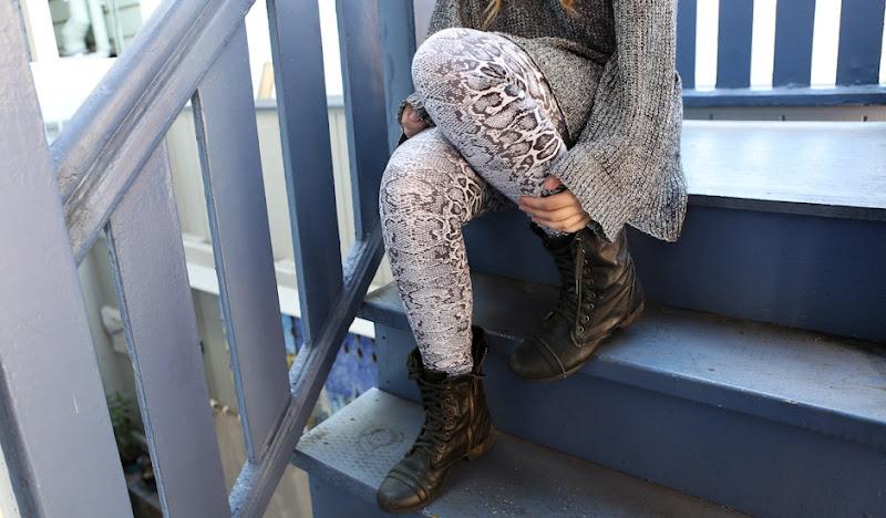 Snakeskin Leggings sit on stairs