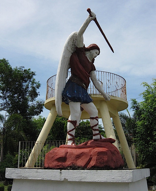 statue of St. Michael the Archangel in front of the church in Bacnotan