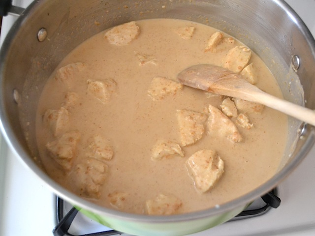 peanut butter and milk added to skillet with chicken to dissolve