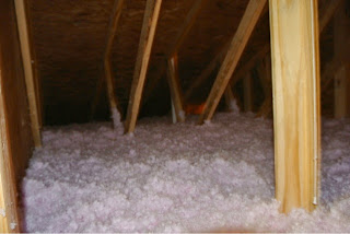 Picture of the attic of the garage with insulation