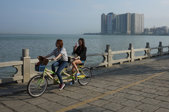 two young women on a twin tandem bicycle in Zhuhai, China