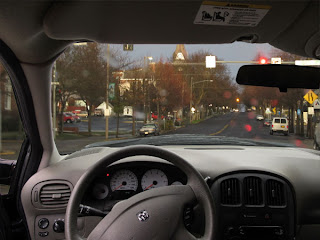 view of the inside of the van and a street scene, with normal vision