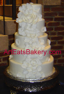 Five tier fondant elegant wedding cake with a dramatic unique white sugar flower design