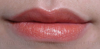 NARS Casablanca lipstick swatched on lips. peachy orange coral