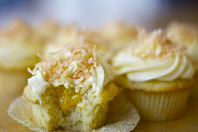 Mango filled Coconut Cupcakes with Mango Frosting via The Baker Chick