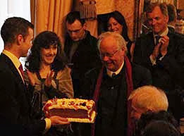 Irish Poet Brendan Kennelly with his birthday cake surrounded by Minister Jimmy Deenihan, Rugby Player Hugo MacNeill and Sandrine Brisset
