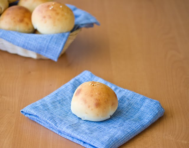 photo of a bread roll on a blue napkin