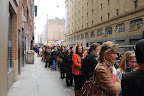 Braving the cold, shoppers stand in line for the sale.