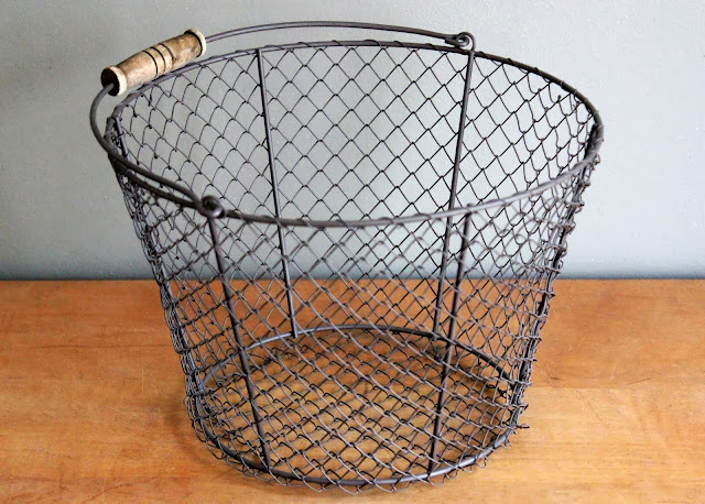 Wooden-handled chicken wire basket available for rent from www.momentarilyyours.com, $3.00.