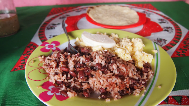 Typical Nicaragua breakfast: rice and beans, scrambled egg, cheese, and tortillas.