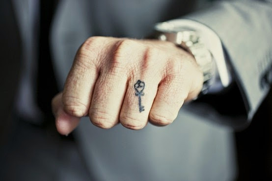 tattoo on ring finger