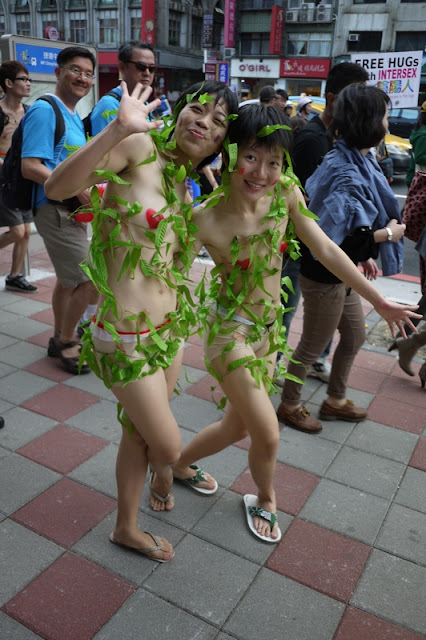 same two young women who are dressed with minimal covering and vines