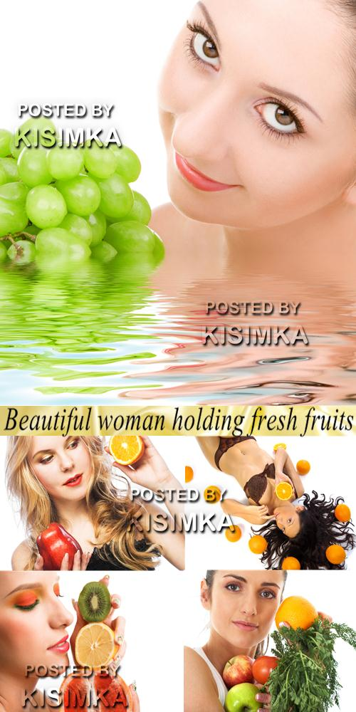 Stock Photo: Beautiful woman holding fresh fruits