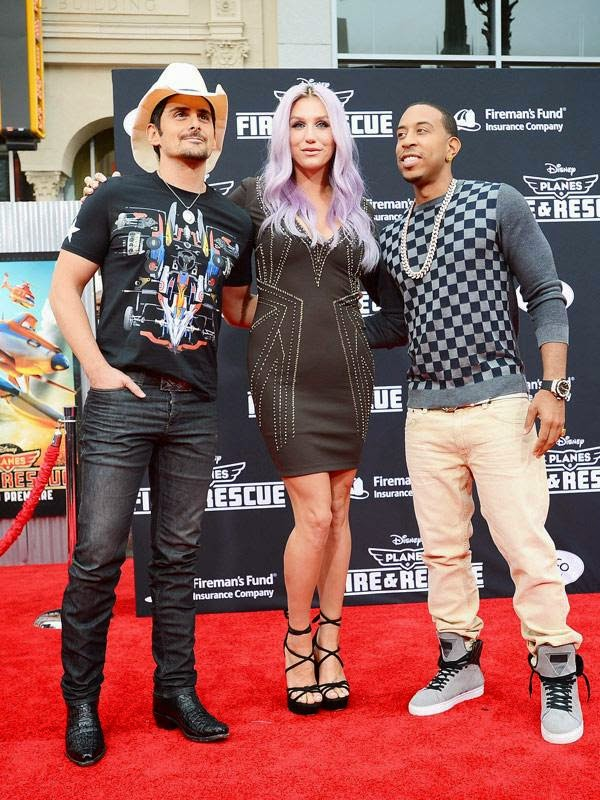 From left, Brad Paisley, Kesha and Ludacris arrive at the world premiere of 'Planes: Fire And Rescue' at El Capitan Theatre on Tuesday, July 15, 2014, in Los Angeles.