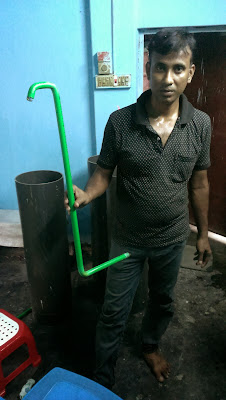 Our engineer custom-welding the external pipe to the water filter (made of PVC pipe)