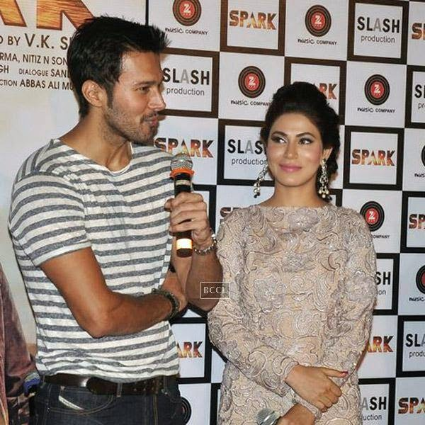 Rajneesh Duggal speaks as Manasha Bahl looks on during the trailer launch of Bollywood movie Spark, held at PVR in Mumbai, on July 21, 2014.(Pic: Viral Bhayani)