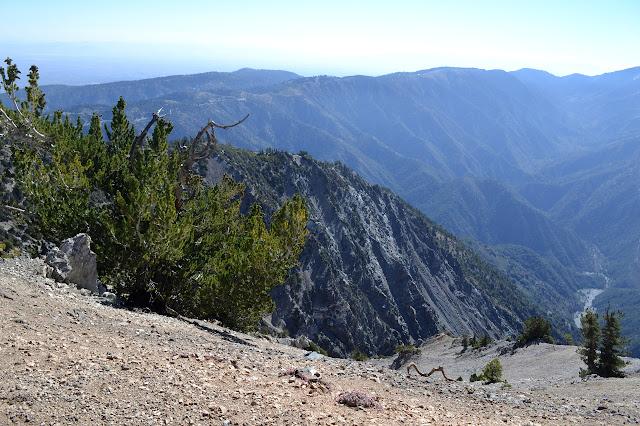 steep hillsides to a distant valley floor