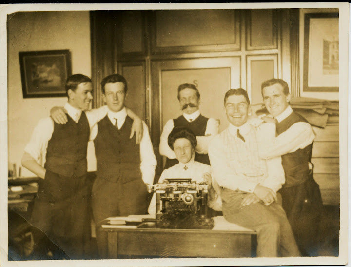 "Staff of Messrs. Robertson & Marks, Milne at right (L to R:  Robertson, Gould, De Putron, Pitt, Milne, Miss Robertson"")"