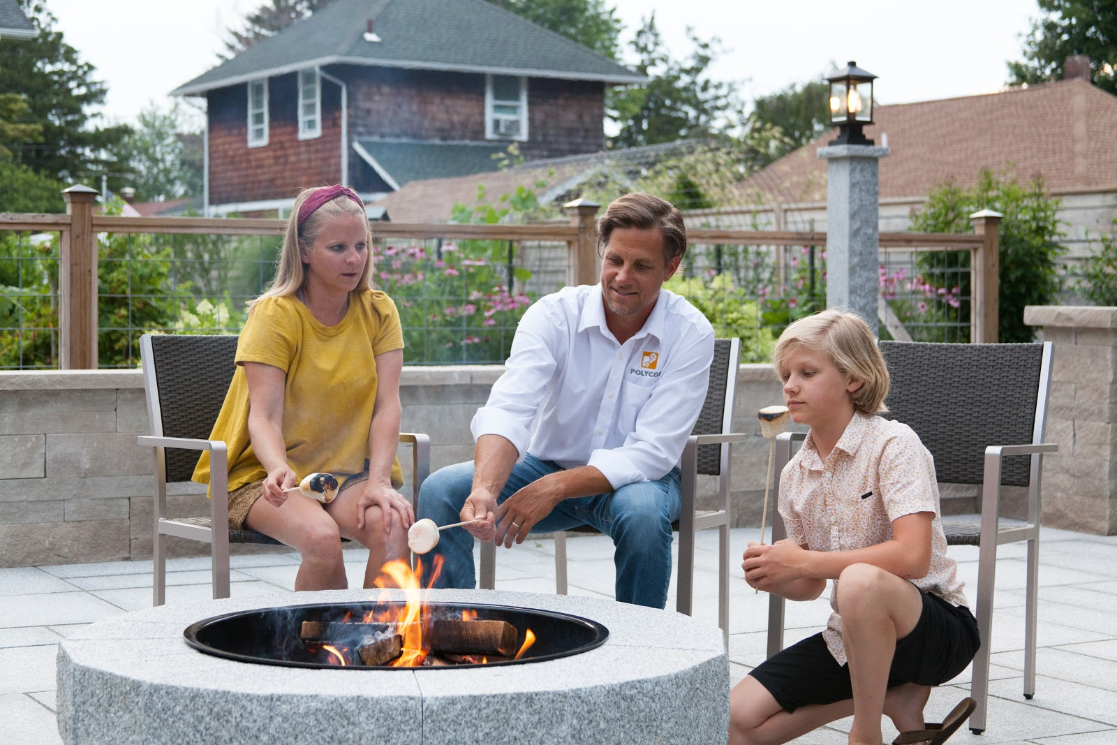 Family by the granite fire pit