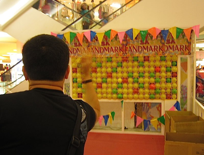 balloon and dart game at Landmark Department Store