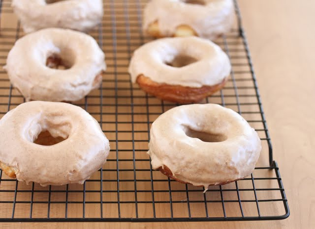 photo of glazed donuts on a baking rack