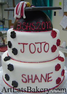 Two tier white, black and red unique custom graduation cake design idea with cap topper picture