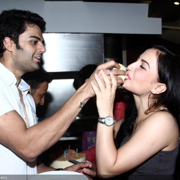 Manish Paul with his Mickey Virus co-star Elli Avram during her b'day bash, held in Mumbai.