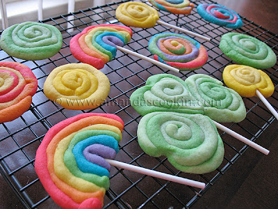 A close up photo of a St. Patrick\'s day rainbow cookies resting on a cooling rack.