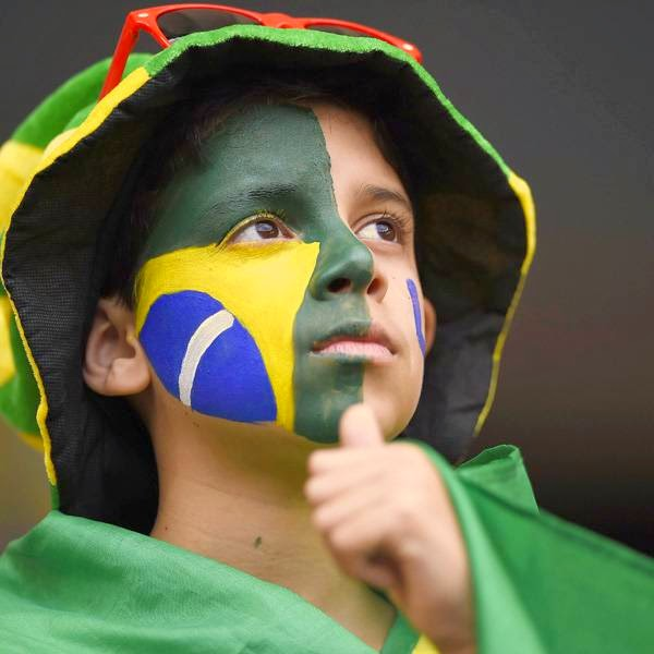 A Brazilian fan waits for the start of the third place play-off football match between Brazil and Netherlands during the 2014 FIFA World Cup at the National Stadium in Brasilia on July 12, 2014.