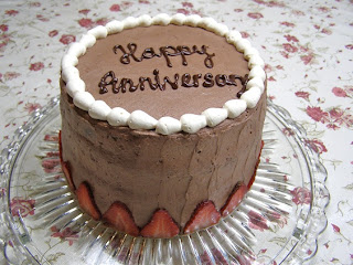 Four layer chocolate genoise cake with strawberry-and-cream filling ...