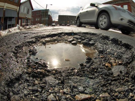 Michigan voters decide on tax hike to repair roads