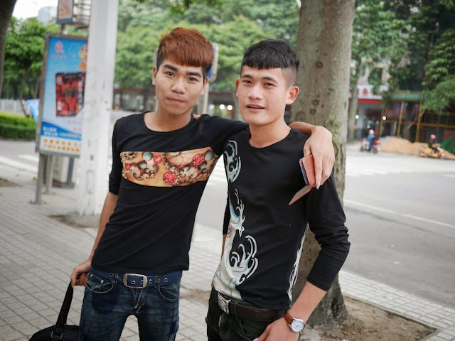 two young men wearing shirts with creative designs in Zhanjiang
