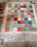 Place the quilt top in the centre of the batting
