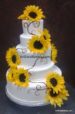 Five tiered white fondant unique modern wedding cake design with sunflowers and hand painted swirls