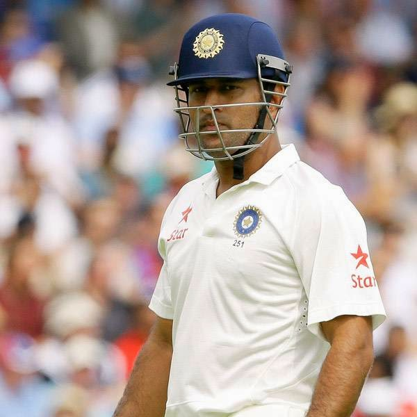 India's MS Dhoni leaves the field after being caught by England's Ian Bell during the fourth day of the second test match between England and India at Lord's cricket ground in London, Sunday, July 20, 2014.