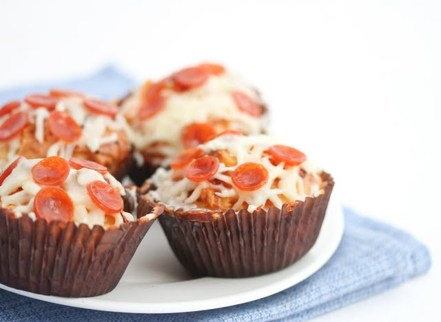 a close-up of pizza cupcakes on a white plate